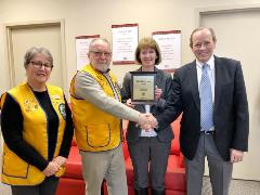 The Lions Club present Russ & Sharon Culver with plaque to recognize their support throughout the Christmas season.